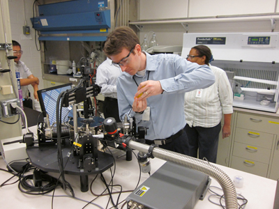 UK alum Joe Bullock works on equipment in the team's lab at the Phillips 66 Research Center.